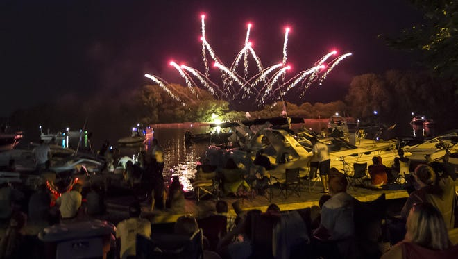 People come to watch the Festival Foods fireworks display Saturday, July 4, at Menominee Park.
