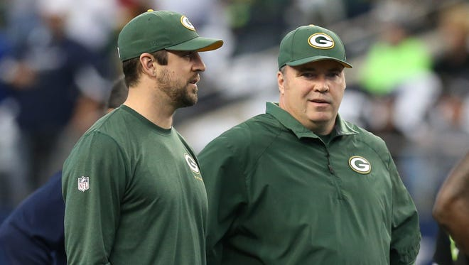 It seems Packers QB Aaron Rodgers, left, will be in street clothes next to Mike McCarthy again on Sunday.