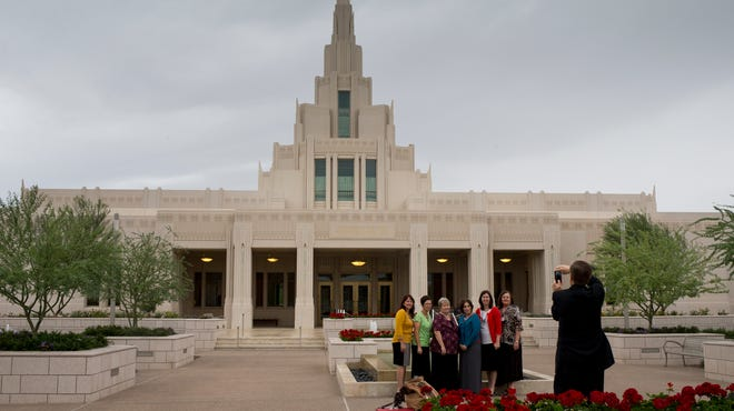 People get their picture taken in front of the new Church of Jesus Christ of Latter-day Saints' temple in Phoenix.