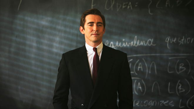 """This photo released by AMC shows Lee Pace as Joe MacMillan in a scene from the television series, """"Halt and Catch Fire,"""" season 1. The drama, which debuted Sunday, is set during the 1980s race to develop and market personal computers."""