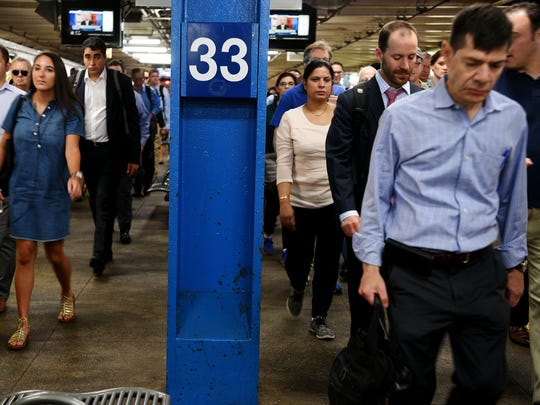 Additional commuters funnel through the 33rd Street PATH station in Manhattan after being rerouted through Hoboken due to the beginning of repairs in New York Penn Station.