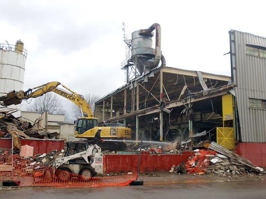 A crew from Eslich Demolition tears down the former
