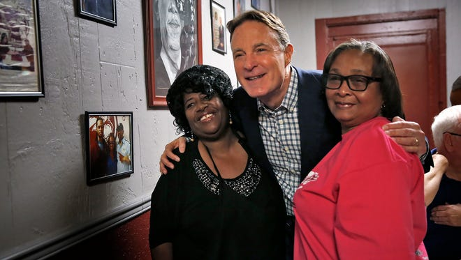 Senator Evan Bayh, center, poses for a photo with Tammie Williams, left, and Nora Stockton, right, at the Kountry Kitchen for breakfast at the start of a day of campaigning with John Gregg, Democratic candidate for governor, and Indianapolis Mayor Joe Hogsett, Saturday, October 15, 2016.