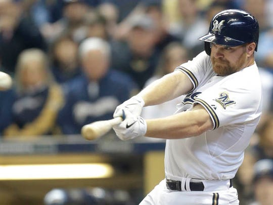 Adam Lind #24 of the Milwaukee Brewers hits a single during the second inning against the Colorado Rockies during Opening Day against the Milwaukee Brewers at Miller Park on April 06, 2015 in Milwaukee, Wisconsin.