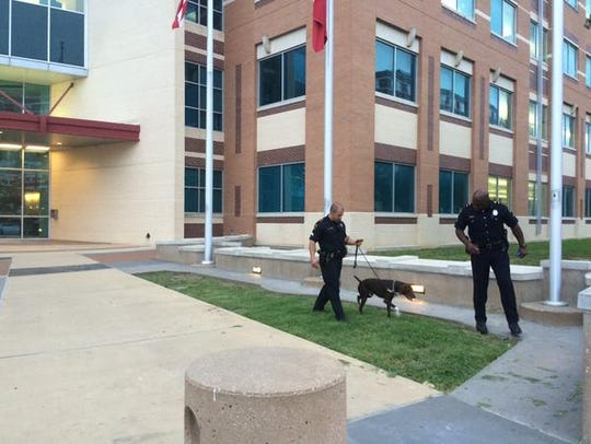 Police use dogs to check for explosives at Dallas police
