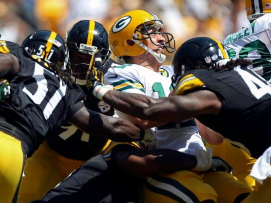 Aug 23, 2015; Pittsburgh, PA, USA; Green Bay Packers quarterback Aaron Rodgers (12) is sacked by the Pittsburgh Steelers defense for a safety during the first half at Heinz Field. Mandatory Credit: Jason Bridge-USA TODAY Sports