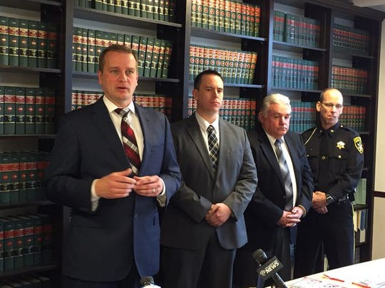 Broome County District Attorney Steve Cornwell, left,