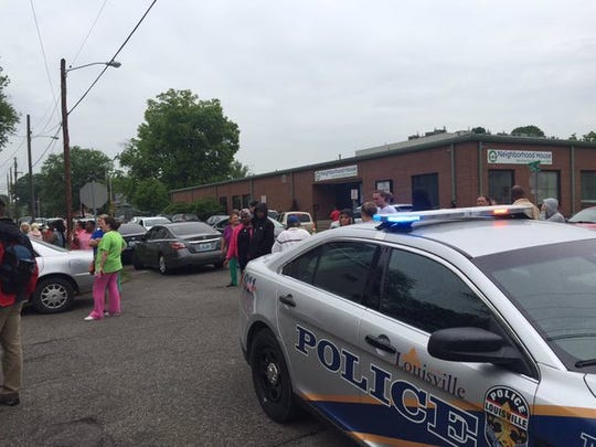 Scene outside fatal shooting of woman at 25th and Rowan streets in Louisville.