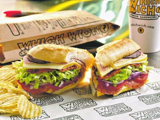 The signature Wicked sandwich at Which Wich includes five meats: turkey, ham, roast beef, pepperoni and bacon.