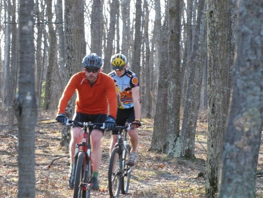 Bikers take a ride at Hanson Hills in Grayling.