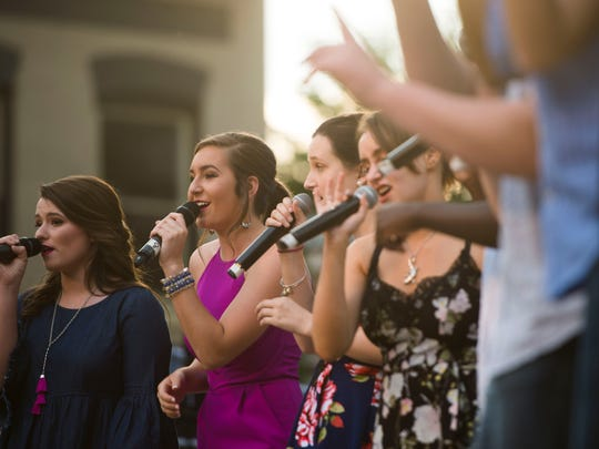 In pink, Carter's Emma Cannon sings at the CTE Goes Live performance in Market Square Friday, May 4, 2018.