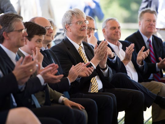 Attendees clap during the announcement of Belgian bus