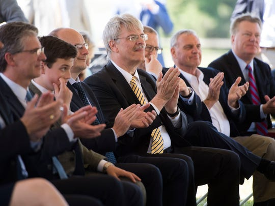 Attendees clap during the announcement of Belgian bus company Van Hool building a factory in Morristown, Tenn. and creating more than 600 jobs, Thursday, April 12, 2018.