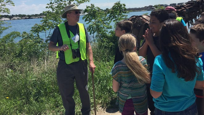 Tom Dennis, a volunteer with the Friends of the St. Clair River, addresses fifth-graders from Howard D Crull Elementary School.
