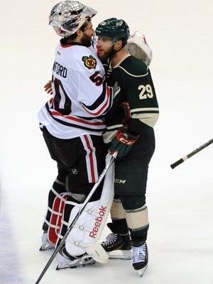 Minnesota Wild forward Jason Pominville (29) congratulates Chicago Blackhawks goalie Corey Crawford (50) on his win in game four of the second round of the 2015 Stanley Cup Playoffs at Xcel Energy Center.