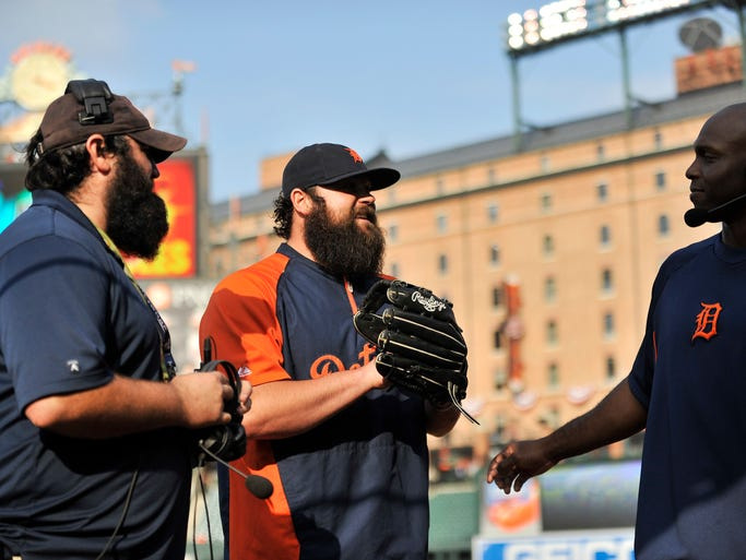 During an MLB Network interview, the Tigers Torii Hunter, right, has pitcher Joba Chamberlain, center, come over to meet Mike Kincaid, MLB Network ballpark cam technician, left, during a workout session., as the   Tigers prepare for the American League Division Series against the Baltimore Orioles at Camden Yards in Baltimore,  on Wednesday, Oct. 1, 2014.