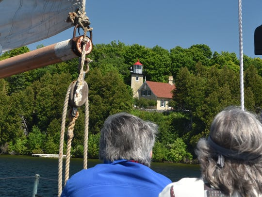 Guests aboard the schooner Edith M. Becker sail by