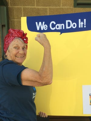 Miriam Kashia, of North Liberty, dressed as Rosie the Riveter