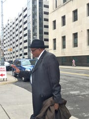 Stanley Johnson, principal at Hutchinson Elementary in Detroit, refuses to talk to reporters after pleading guilty May 4 to accepting $84,000 in kickbacks from a crooked vendor.