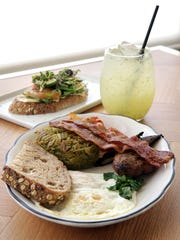 The Londoner from Salt + Honey Bakery Café is shown with mint lemonade and hummus and avocado toast.