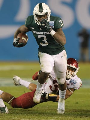 Michigan State running back LJ Scott runs the ball against during the fourth quarter of MSU's 42-17 win over Washington State in the San Diego County Credit Union Holiday Bowl on Thursday, Dec. 28, 2017, in San Diego.