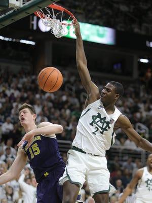 Michigan State's Jaren Jackson Jr. dunks over Michigan's Jon Teske in the first half Saturday, Jan. 13, 2018 at the Breslin Center in East Lansing.
