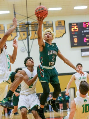 Lawrence North guard Mike Saunders (3) goes to the bucket in the Wildcats' sectional win over Cathedral on Tuesday night.