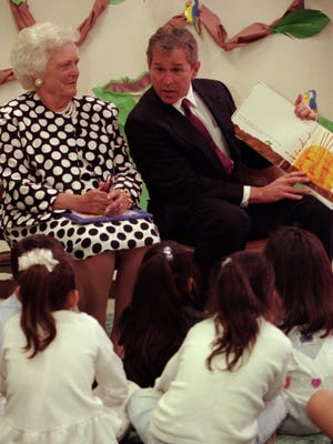 04/02/1998 Former First Lady Barbara Bush, left, and her son, Texas Governor George Bush read to youngsters at the YWCA on Brown in Central El Paso Thursday.