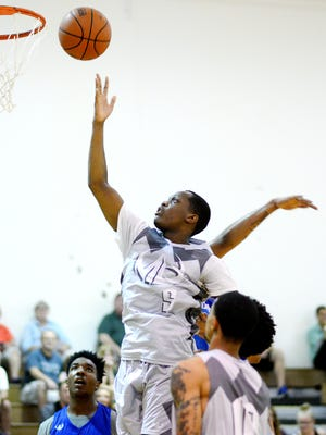 Team Quicksilver and Michigan State guard Cassius Winston lays in a basket on Thursday, June 28, 2018, during a Moneyball Pro-Am summer basketball league game at Aim High in Dimondale.