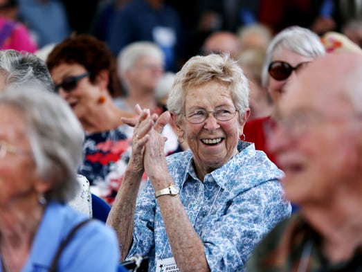 Carolyn Hoodmaker applauds during the grand opening for the Fort Collins Senior Center's newly expanded center Thursday, July 10, 2014.