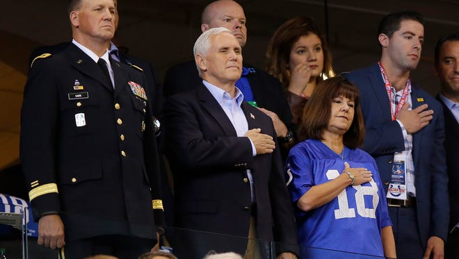 Vice President Mike Pence stands during the playing of the national anthem before an NFL football game between the Indianapolis Colts and the San Francisco 49ers, Sunday, Oct. 8, 2017, in Indianapolis. (AP Photo/Michael Conroy) ORG XMIT: NAS111