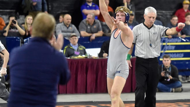 Great Falls High's Jordan Komac points to his father and coach Steve after winning the 160-pound Class AA state title during the championship round of the all-class state wrestling tournament at MetraPark in Billings in February.