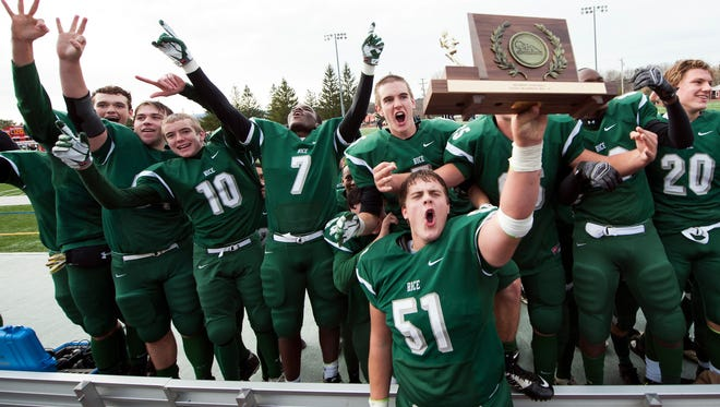 Rice celebrates the championship in front of the fans during the Vermont high school division II championship football game at Rutland High School on Saturday.