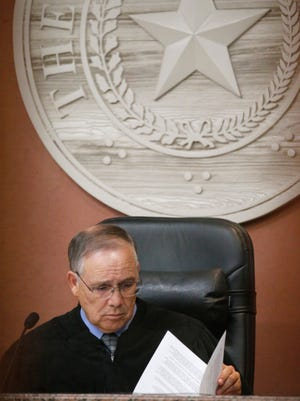 Judge Luis Aguilar received a written reprimand Monday by the Texas State Commission on Judicial Conduct after nine complaints were filed against him, records show.