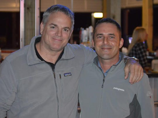 """KC Marina Pointe The new KC's Marina Pointe opened recently, and owners Kerry """"KC"""" Chesser and Chad Brady posed to celebrate the evening."""