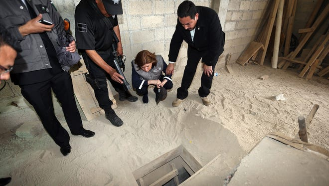 """Mexico's Attorney General Arely Gomez looks at the alleged end of the tunnel through which Mexican drug lord """"El Chapo"""" could have escaped from the Altiplano prison on July 12, 2015."""