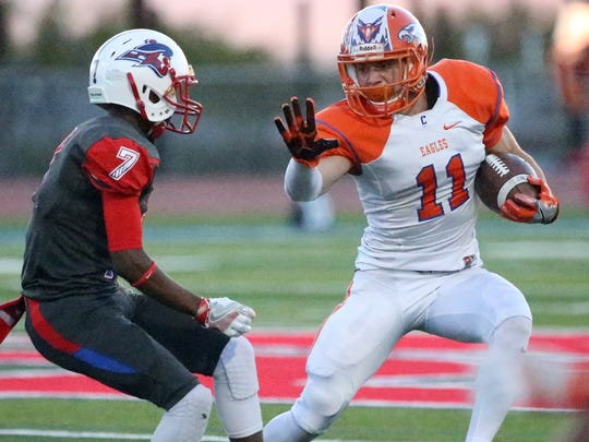 Canutillo running back Aaron Moya, 11, tries to get around Bel Air's Jailon Gentry, 7, Friday night.