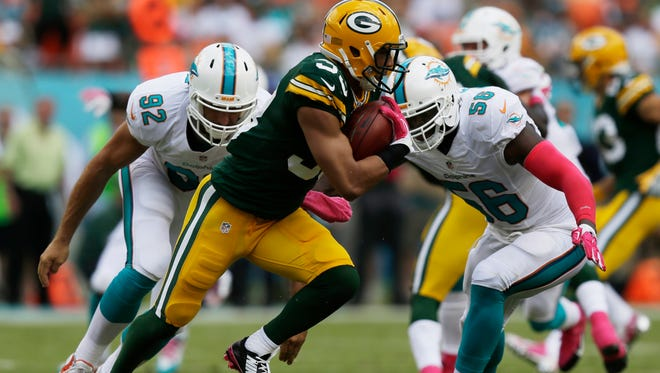 Green Bay Packers free safety Micah Hyde (33) carries the ball during the first half against the Miami Dolphins, Sunday, Oct. 12, 2014, in Miami Gardens, Fla.