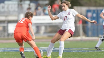 St Thomas More's Reagan Crawford  works to move the ball around a defender as STM girls soccer takes on Mount Carmel in Lafayette, La., Saturday, Jan. 14, 2017.