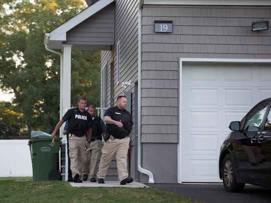 Law Enforcement try to make arrests at the home of