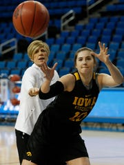 Iowa Hawkeyes forward Megan Gustafson (10) works against associate head coach Jan Jensen during practice Friday, March 16, 2018 at Pauley Pavilion on the campus of UCLA. (Brian Ray/hawkeyesports.com)