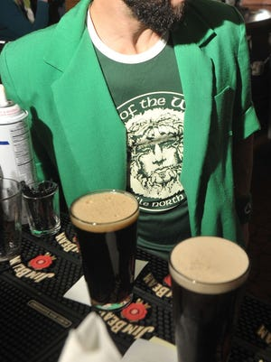 Guinness is served on a previous St. Patrick's Day at Jack of the Wood on Patton Ave. in Asheville.