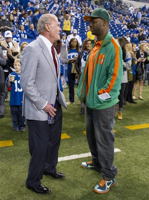 Former Indianapolis Colt Reggie Wayne talks with team owner Jim Irsay during pre-game activities of an NFL football game Sunday, Nov. 29, 2015, at Lucas Oil Stadium.