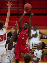 Vero Beach's Tommie Lewis (3) puts a shot up against South Fork's defense in the first half of their game at South Fork High School in Stuart on Friday.