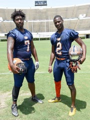 A Dandy Dozen duo from Callaway, James Williams (left) and Malik Heath, pose for pictures at the photo shoot at Mississippi Veterans Memorial Stadium in Jackson on July 26, 2017.
