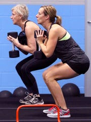 Kristin Melnick (front) and Hanne Bonovich work out