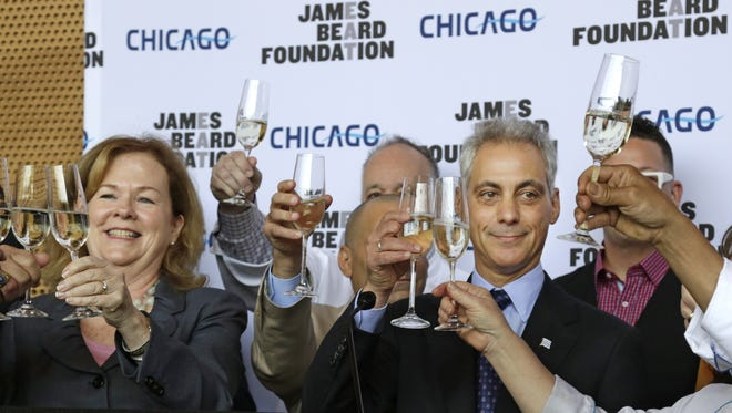 Susan Ungaro, President of the James Beard Foundation, left, and Chicago Mayor Rahm Emanuel, right, toast with the cities top chefs at a news conference Tuesday, May 20, 2014, in Chicago. The pair announced that after 24 years in the New York, the James Beard Foundation awards ceremony is moving to the Windy City next year. The foundation ? which is based in New York and honors the nation's best chefs, restaurants and food media ? says several cities had asked to host the annual awards ceremony, but Chicago's offer of marketing and sponsorship support was too good to turn down. (AP Photo/M. Spencer Green)