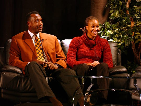 Tamika Catchings and her father Harvey Catchings, a former NBA player, participate in the Family of Sport Symposium for Martin Luther King, Jr. Day on January 17, 2005 at FedexForum in Memphis, Tenn.