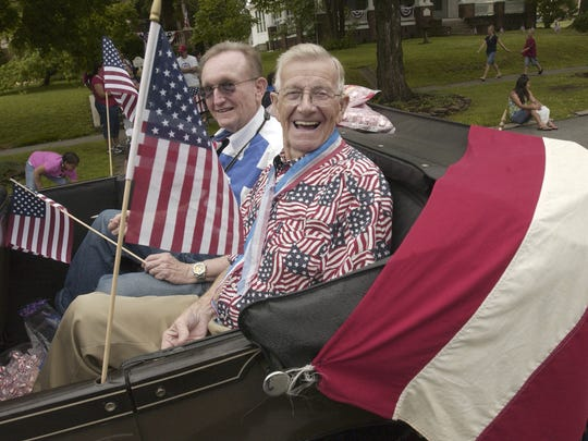 Springfield City Councilmen Ralph Manley, right , and John Wiley rode in a car in the Midtown Neighborhood Association's 18th Annual 4th of July Parade. 2008