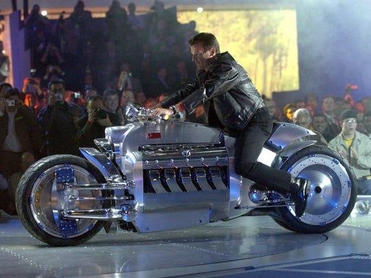 Wolfgang Bernhard of Chrysler rides a concept Dodge